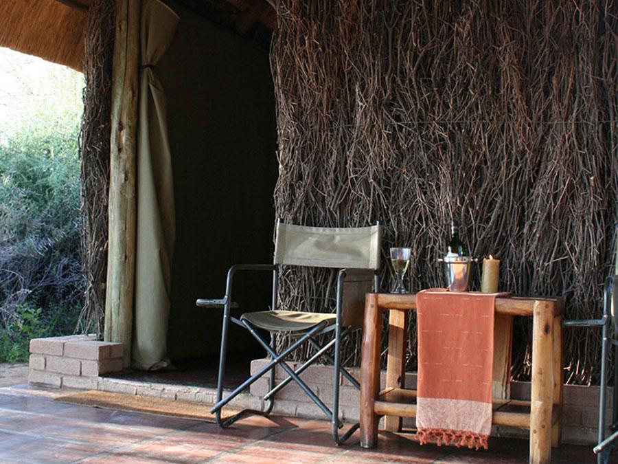 Enlarge bush camp patio